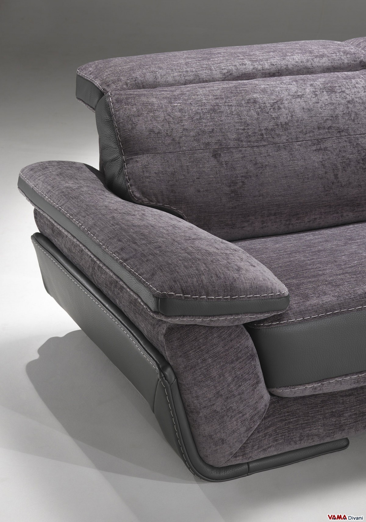 Leather and fabric sofa with reclining headrests