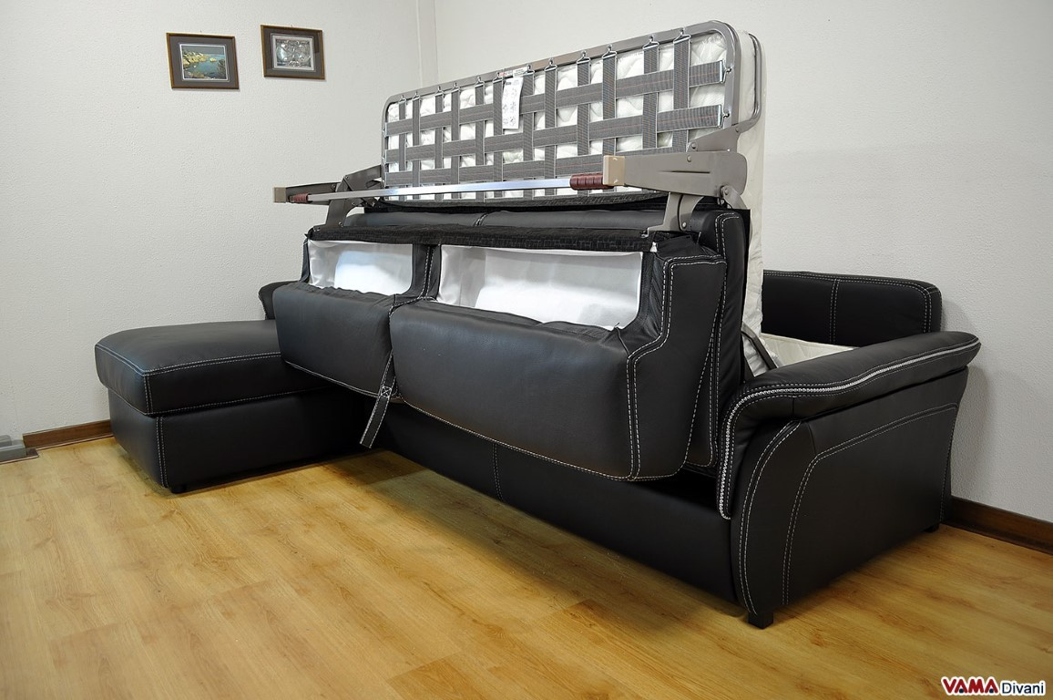 Leather sofa bed with wooden finishing in its arms