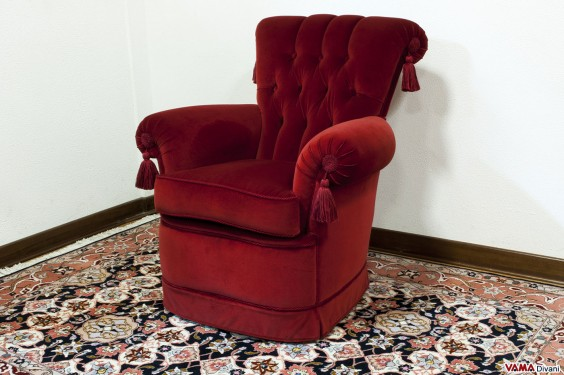 Bedroom velvet armchair with buttoned details on its back