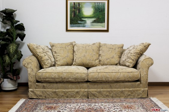 Classic sofa with decorative cushions in the back
