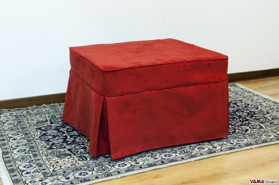 Footstool bed with red skirted slipcover