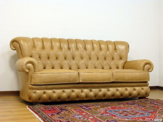 Leather sofa with buttoned seat back and base in ochre colour