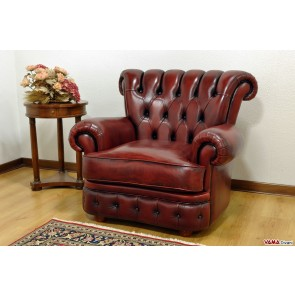 Luxury red armchair in hand-distressed leather