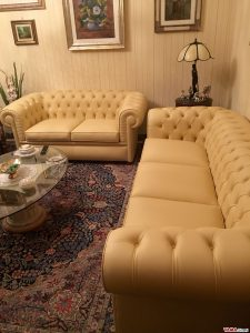Chesterfield sofas in beige leather