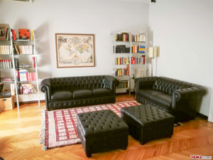 Black Chesterfield sofas whit pouffes